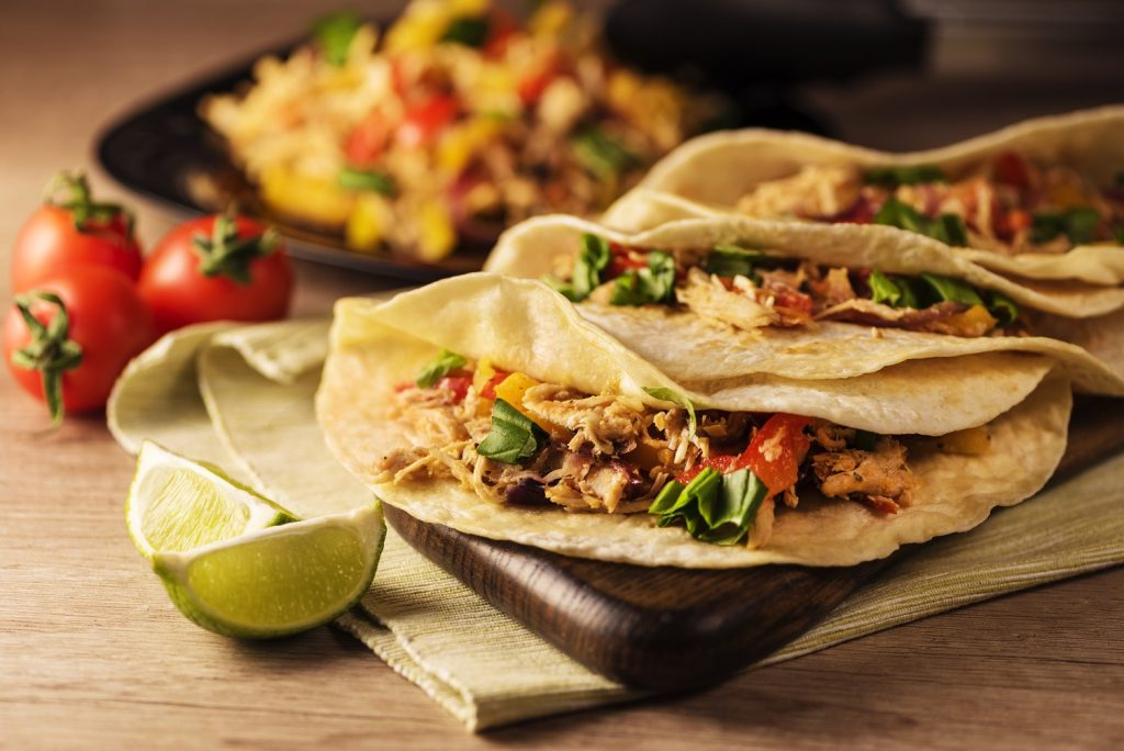 Mexican tacos with lime in front