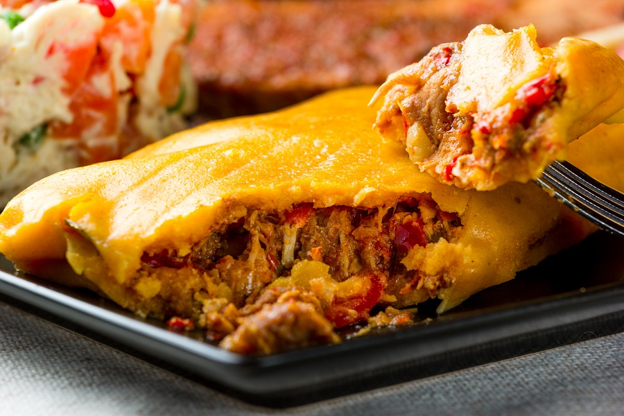 Tamale broken up to show inside of the maza and stuffing.